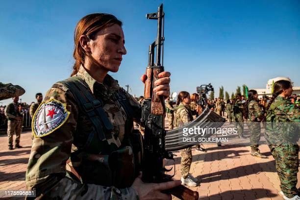 TOPSHOT Mourners attend a funeral for Kurdish political leader Hevrin Khalaf and others including civilians and Kurdish fighters in the northeastern...