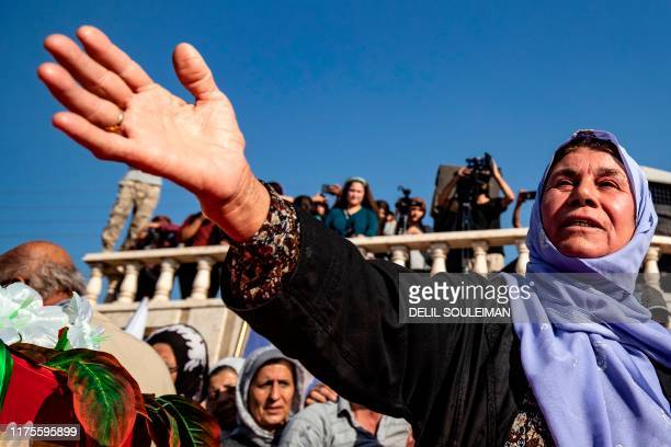 Mourners attend a funeral for Kurdish political leader Hevrin Khalaf and others including civilians and Kurdish fighters in the northeastern Syrian...