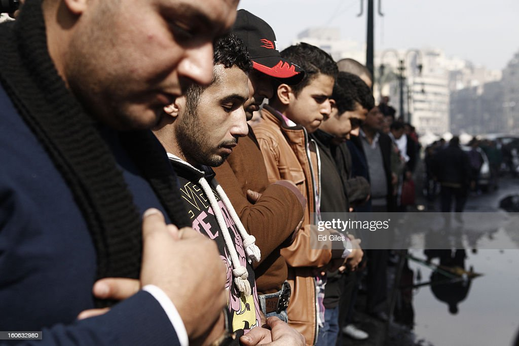Mourners attend a funeral for two protesters killed during violent clashes with Egyptian security forces in the Egyptian capital in previous days, at the Omar Makram Mosque in Tahrir Square, on February 4, 2013 in Cairo, Egypt. The funeral, held for Egyptian protesters Mohammed al Guindy and Amr Saad who were killed during fighting with riot police at protests near Cairo's Tahrir Square and outside Egypt's Presidential Palace. Protests have continued across Egypt nearly more than one week after the second anniversary of the Egyptian Revolution that overthrew former President Hosni Mubarak on January 25, 2011.