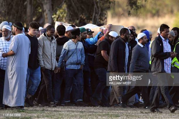 Mourners attend a funeral for victims of the twin mosque attacks at the Memorial Park cemetery in Christchurch on March 20 2019 A Syrian refugee and...