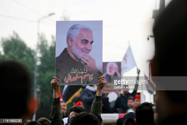 Mourners attend a funeral procession for Iraqi paramilitary chief Abu Mahdi al-Muhandis and Iranian military commander Qasem Soleimani , in...