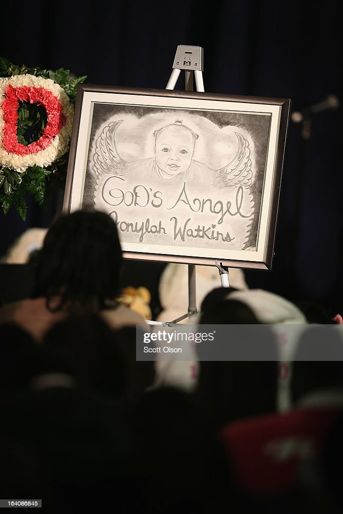 Mourners attend a funeral service for six-month-old Jonylah Watkins at New Beginnings Church on March 19, 2013 in Chicago, Illinois. Watkins was shot, along with her father, while sitting on her father's lap in the family's minivan March 11. Jonylah died the following day. Her father is recovering from his wounds.