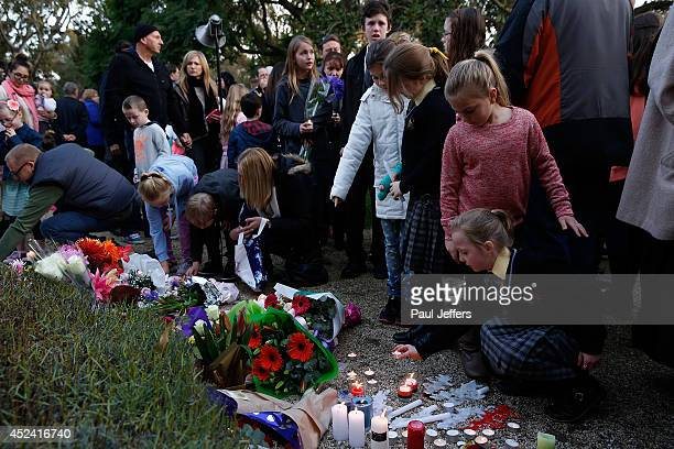Mourners attend a memorial service held for a family of five killed in the flight MH17 disaster in the suburb of Eynesbury on July 20 2014 in...