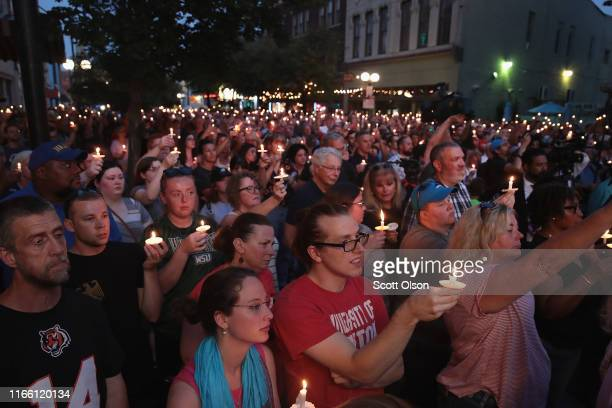 Mourners attend a memorial service in the Oregon District to recognize the victims of an earlymorning mass shooting in the popular nightspot on...