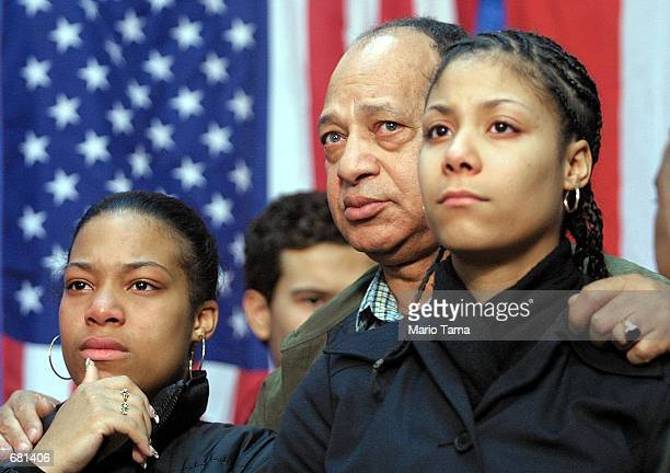 Mourners attend a service for family members of the victims of the American Airlines Flight 587 crash November 12, 2001 in the Washington Heights...