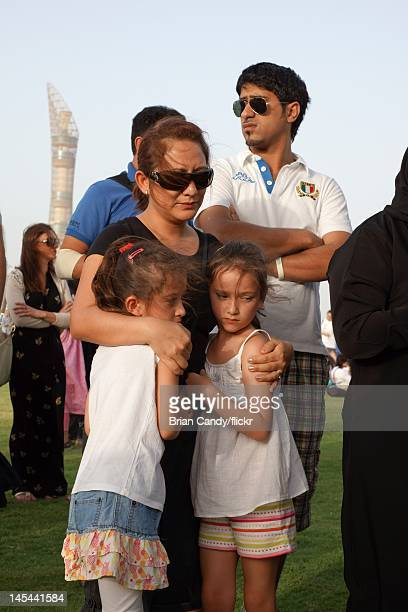 Mourners attend a vigil for the 19 victims of the Villaggio mall fire in Aspire Park on May 29 2012 in Doha Qatar 13 of the victims believed to be...
