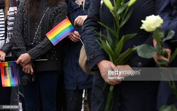 Mourners attend a vigil for victims of a shooting at a gay nightclub in Orlando Florida the previous day in front of the United States embassy on...