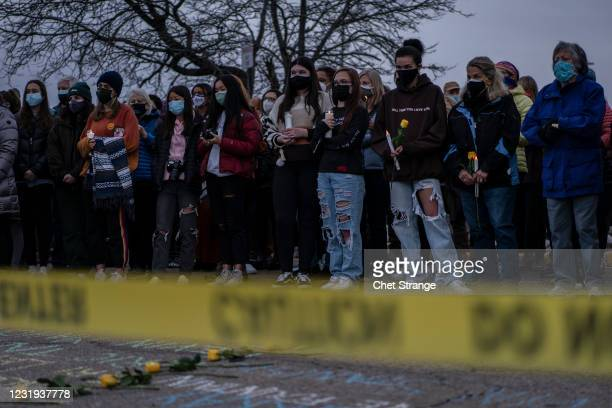 Mourners attend a vigil to commemorate the victims of a mass shooting at a King Soopers grocery store on Thursday, March 25, 2021 in Boulder,...