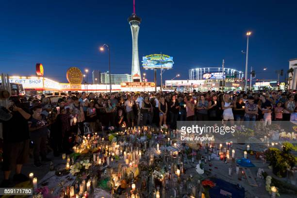 Mourners attend a vigil to mark one week since the mass shooting at the Route 91 Harvest country music festival on the corner of Sahara Avenue and...