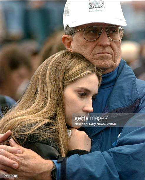 Mourners attend memorial service in the Mann Theater parking lot for victims at Columbine High School in Littleton Colo where two teenagers shot to...