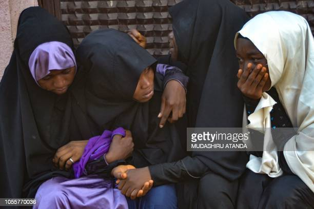 Mourners attend the burial of the alleged victims of the violent clashes in Abuja between Nigeria police and members of the Islamic Movement of...