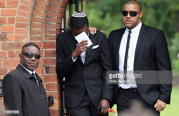 Mourners attend the cremation of Amy Winehouse at Golders Green Crematorium on July 26 2011 in London England Winehouse was found dead in her flat in...
