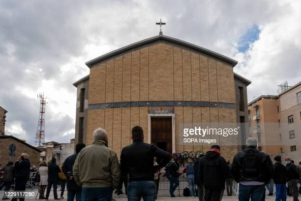 Mourners attend the funeral ceremony of the Calabria regional governor Jole Santelli held at St. Nicholas Church in Cosenza. A funeral ceremony of...