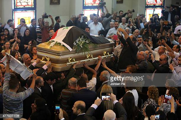 Mourners attend the funeral for Tariq Aziz the former Iraqi deputy prime minister and top aide of Saddam Hussein at the St Mary of Nazareth church on...