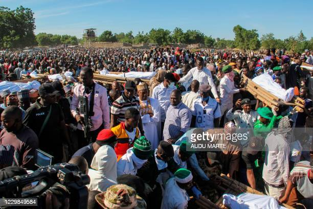 Mourners attend the funeral of 43 farm workers in Zabarmari, about 20km from Maiduguri, Nigeria, on November 29, 2020 after they were killed by Boko...