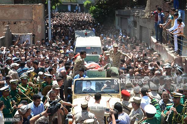 Mourners attend the funeral of Army officer Mustafa elWetedi one of the four Egyptian soldiers who were killed the day before by a roadside bomb in...