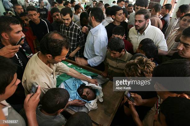 Mourners attend the funeral of Hussam abu Kenas who was killed during fighting between Hamas and Fatah militants at his funeral June 11 2007 in Gaza...