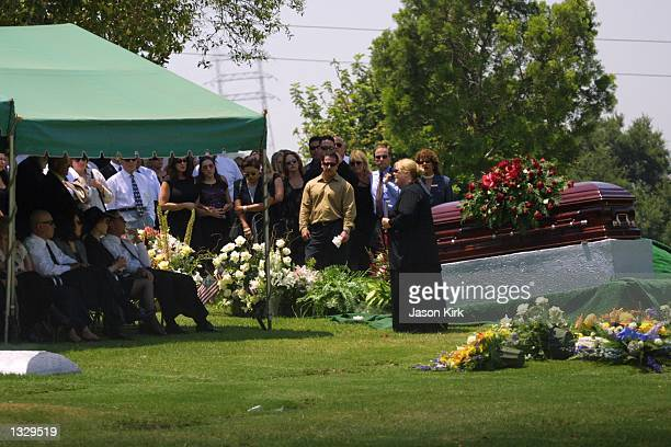 Mourners attend the funeral of Matthew Ansara the son of actress Barbara Eden July 2 2001 in Hollywood CA Matthew Michael Ansara was found dead on...
