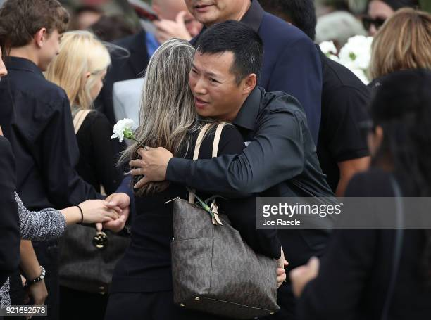 Mourners attend the funeral of Peter Wang who was a JROTC cadet at Kraeer Funeral home on February 20 2018 in Coral Springs Florida Wang was killed...