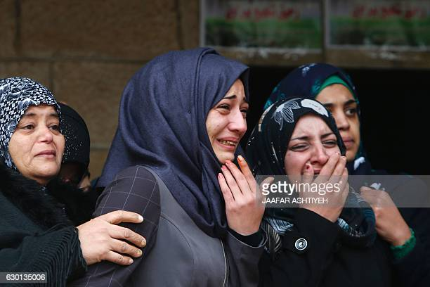 Mourners attend the funeral of Rahik Birawi a Palestinian woman who was killed while allegedly carrying out an attack on Israelis in the West Bank...