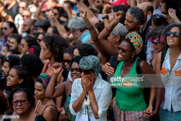 Mourners attend the funeral of slain Brazilian councilwoman and activist Marielle Franco outside Rio de Janeiro's Municipal Chamber in Brazil on...