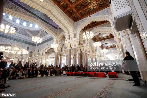 Mourners attend the funeral of slain Huthi leader Saleh alSamad and his six bodyguards at a mosque in the Yemeni capital Sanaa on April 28 after he...