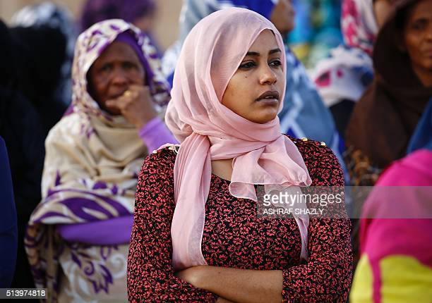 Mourners attend the funeral of Veteran Sudan Islamist opposition leader Hassan alTurabi on March 6 2016 in the capital Khartoum Turabi one of the...