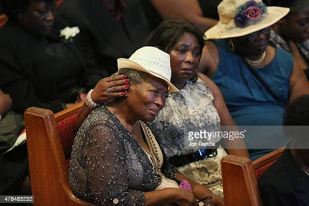 Mourners attend the funeral service of Ethel Lance who was one of nine victims of a mass shooting at the Emanuel African Methodist Episcopal Church...