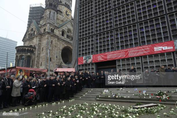Mourners attend the inauguration of a memorial to victims at the site of the 2016 Christmas market terror attack at Breitscheidplatz on the attack's...