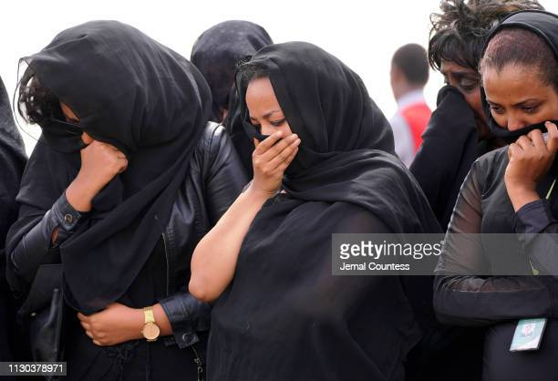 Mourners believed to be Ethiopian Airlines cabin crew members arrive to pay their respects at the crash site of Ethiopian Airlines Flight ET302 on...