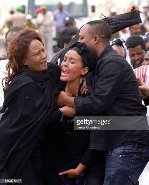 Mourners believed to be family members of a victim onboard the aircraft visit the crash site of Ethiopian Airlines Flight ET302 on March 14 2019 in...
