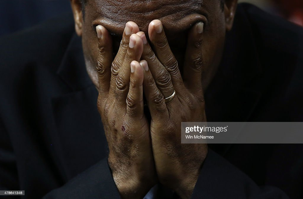 Mourners bow their heads in prayer during the funeral service where U.S. President Barack Obama delivered the eulogy for South Carolina State senator and Rev. Clementa Pinckney who was killed along with eight others in a mass shooting June 26, 2015 in Charleston, South Carolina. Suspected shooter Dylann Roof, 21, is accused of killing nine people on June 17th during a prayer meeting in the church, which is one of the nation's oldest black churches in Charleston.