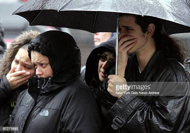 Mourners brave the rain as they stand outside St Mary's Church on Grand St where the funeral service for Nixzmary Brown was being held The 7yearold...