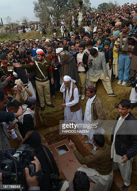 Mourners bury a Pakistani soldier who was shot dead along the Line of Control at a village in Bainso about 45 kms from the capital Islamabad on...