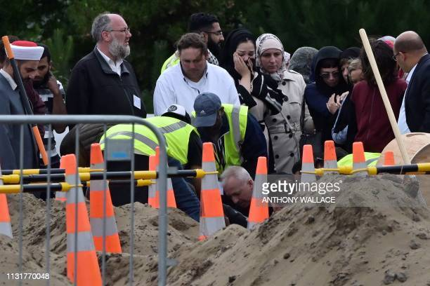 Mourners bury their loved one at the Memorial Park Cemetery in Christchurch on March 21 six days after twin mosque shooting incident that claimed the...