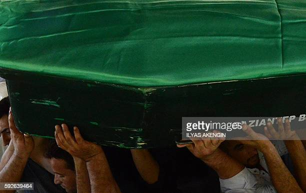 Mourners carry a coffin during the funeral of victims of last night's attack on a wedding party that left 50 dead in Gaziantep in southeastern Turkey...