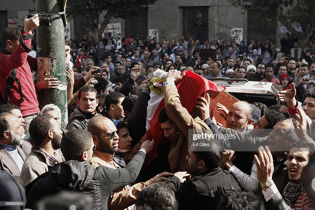 Mourners carry a coffin through the crowds at a funeral for two protesters killed during violent clashes with Egyptian security forces in the Egyptian capital in previous days, at the Omar Makram Mosque in Tahrir Square, on February 4, 2013 in Cairo, Egypt. The funeral, held for Egyptian protesters Mohammed al Guindy and Amr Saad who were killed during fighting with riot police at protests near Cairo's Tahrir Square and outside Egypt's Presidential Palace. Protests have continued across Egypt nearly more than one week after the second anniversary of the Egyptian Revolution that overthrew former President Hosni Mubarak on January 25, 2011.