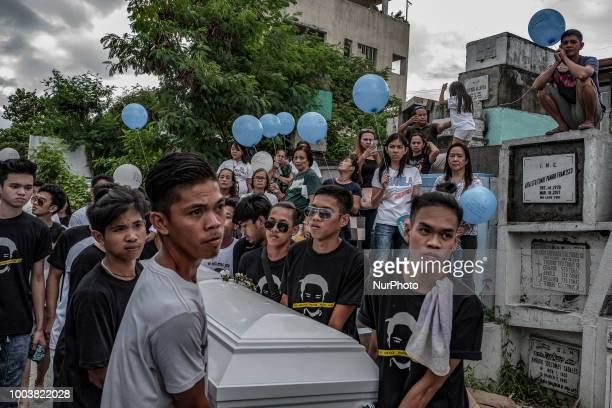 Mourners carry balloons as they take part in the funeral of Jhan Cyrell Ignacio a college freshman who was killed by unidentified gunmen in Malabon...