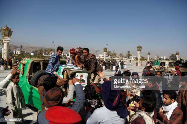 Mourners carry coffins of Houthi fighters who were killed in recent confrontations against forces of the government in Yemen's gas-rich province of...