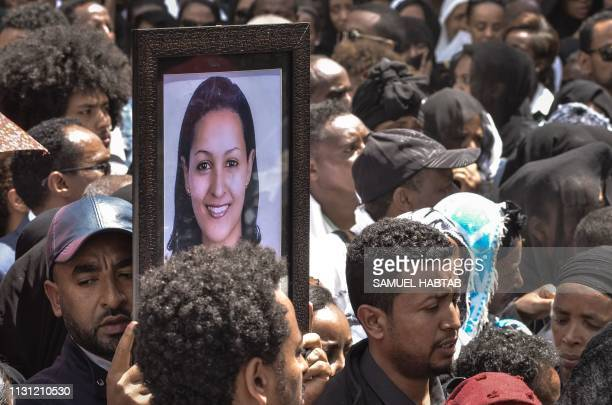 Mourners carry portraits of victims of the crashed accident of Ethiopian Airlines during the mass funeral at Holy Trinity Cathedral in Addis Ababa...