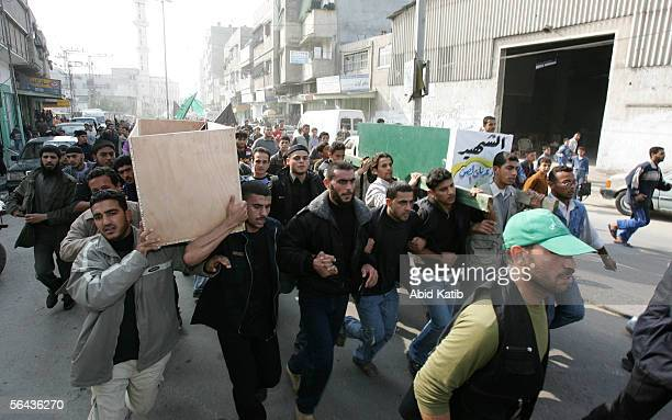 Mourners carry the bodies of Mohammed Joha and Rashad AlSen after their funeral at the alOmary mosque December 15 2005 in Gaza City Gaza Strip Joha...