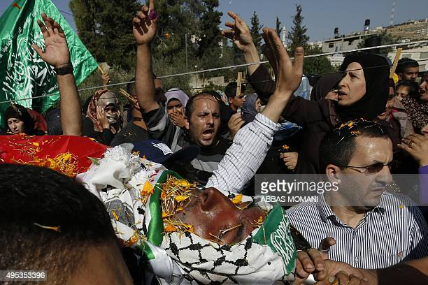 Mourners carry the body of 22year old Mohammed Shamasne during a funeral procession for him and 24year old Omar alFaqih in the West Bank village of...