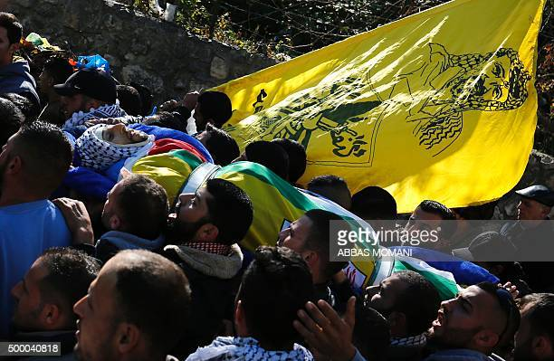 Mourners carry the body of Abdul Rahman Barghouthi during his funeral in the village of Abud between Ramallah and Nablus in the northern West Bank on...