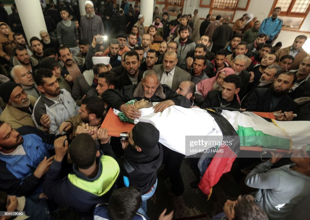 Mourners carry the body of Abdullah Zeidan, a 33-year-old fisherman, during his funeral in Gaza City on January 13, 2018. A fisherman from the Gaza Strip was shot dead by the Egyptian army overnight for unclear reasons, Palestinian officials said Saturday, calling for an immediate investigation into the incident. /