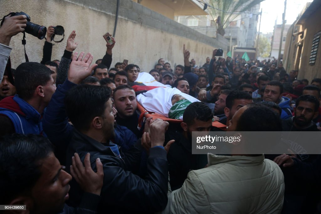 Mourners carry the body of Abdullah Zeidan, a 33-year-old fisherman, during his funeral in Gaza City on January 13, 2018. A fisherman from the Gaza Strip was shot dead by the Egyptian army overnight for unclear reasons, Palestinian officials said Saturday, calling for an immediate investigation into the incident.