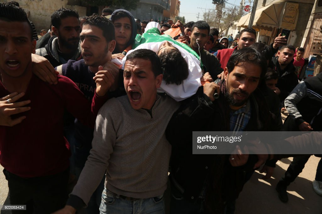 Image contains graphic content) Mourners carry the body of Palestinian Ahmad Abu Al-Helo, 19, during his funeral in Al Bureij refugee camp in the central Gaza strip February 21, 2018.