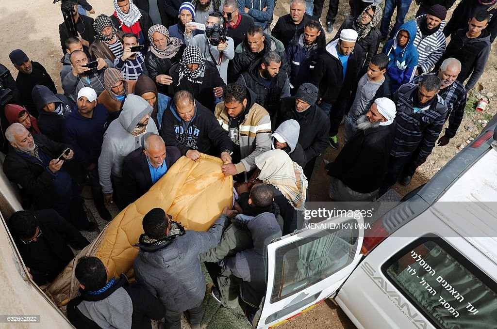 Mourners carry the body of Yacoub Abu al-Qiyan, 50, a Bedouin man who was killed the previous week when Israeli police staged a pre-dawn raid on the Bedouin village of Umm al-Hiran to demolish several homes, as Bedouin and Arab Israelis attend his funeral in the unrecognized Bedouin village in southern Israel on January 24, 2017. Israeli police said he was shot as he deliberately drove at officers, killing a policeman. Residents strongly denied the allegation, calling him a respected teacher and saying that he was shot before losing control of the car. KAHANA