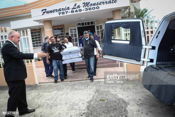 Mourners carry the casket of Sonia Irizarry originally from Puerto Rico who passed away on September 23 in Florida during her funeral on October 14...