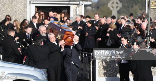Mourners carry the coffin carrying The Cranberries singer Dolores O'Riordan following her funeral at Saint Ailbe's Church Ballybricken