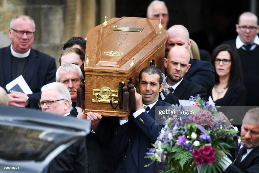 Mourners carry the coffin during the funeral of Bay City Roller guitarist Alan Longmuir at Allan Church on July 12, 2018 in Bannockburn, Scotland. The seventy year old Edinburgh born musician and a founding member of the Bay City Rollers, died at Forth Valley Hospital in Larbert.